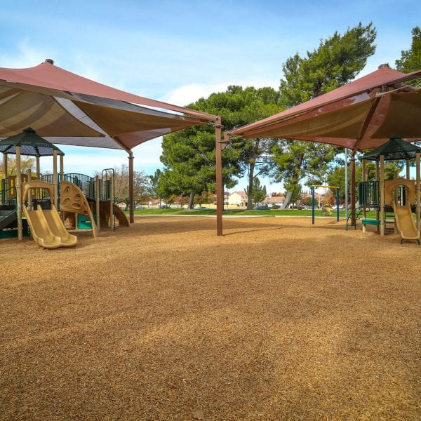 Two tent-covered playgrounds