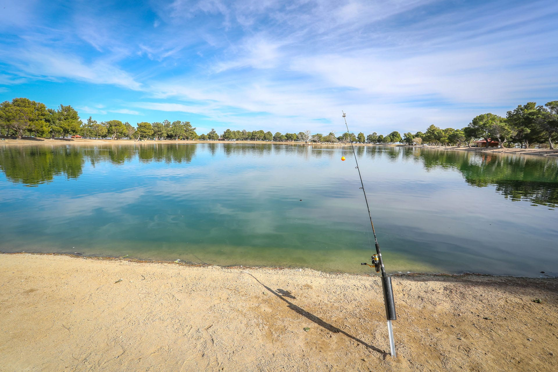 Lake with propped up fishing pole