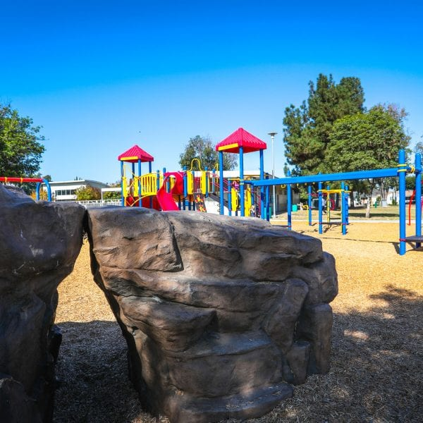 Large rock structures near playground
