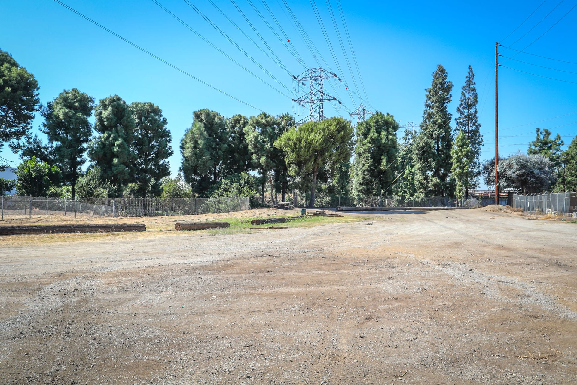 Dirt parking lot and trees