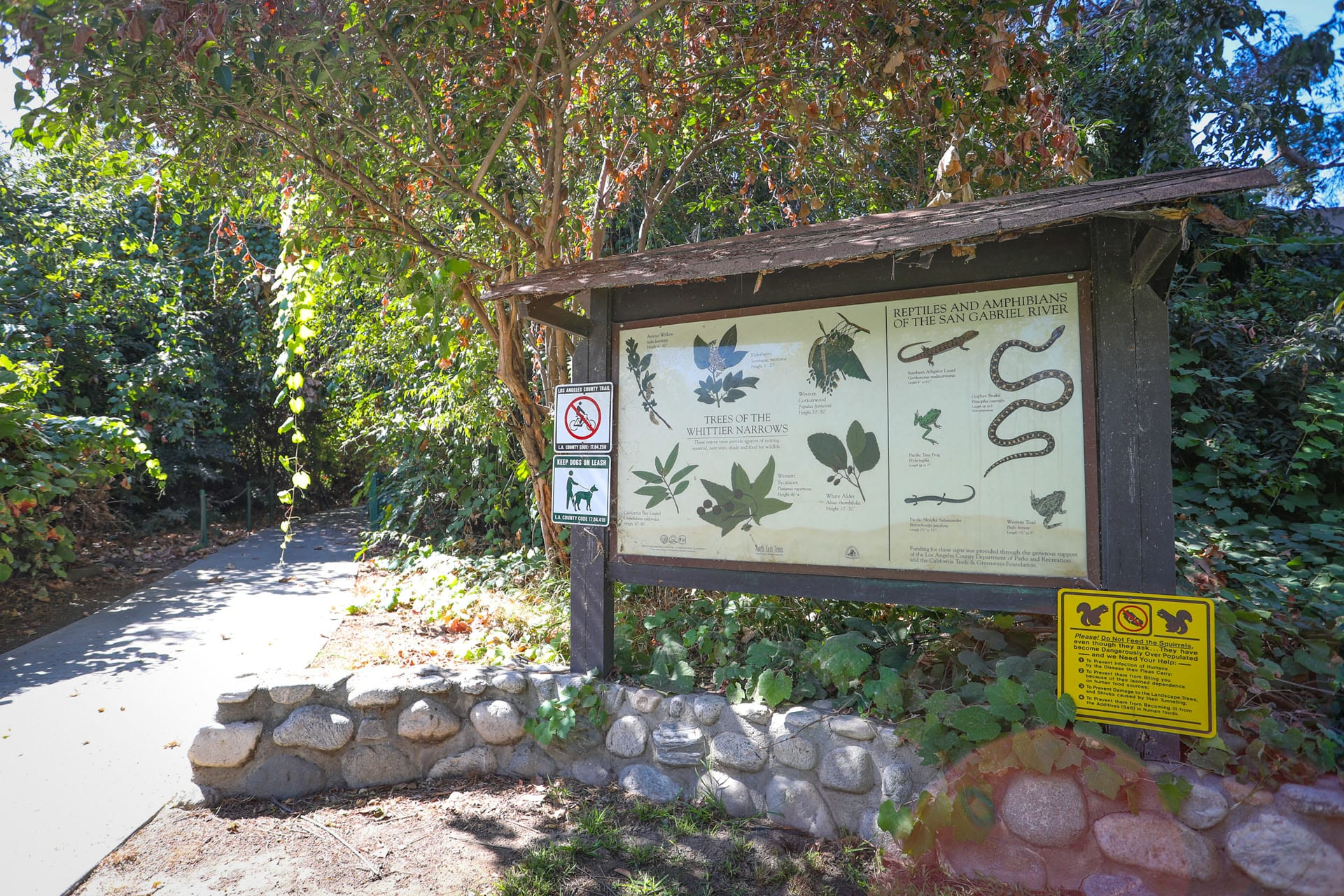 Informational sign next to garden walkway