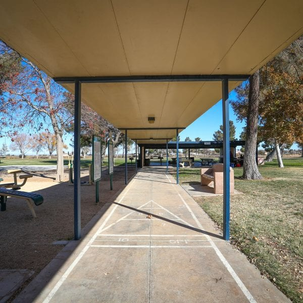Exercise walk way and equipment. Picnic tables at the end