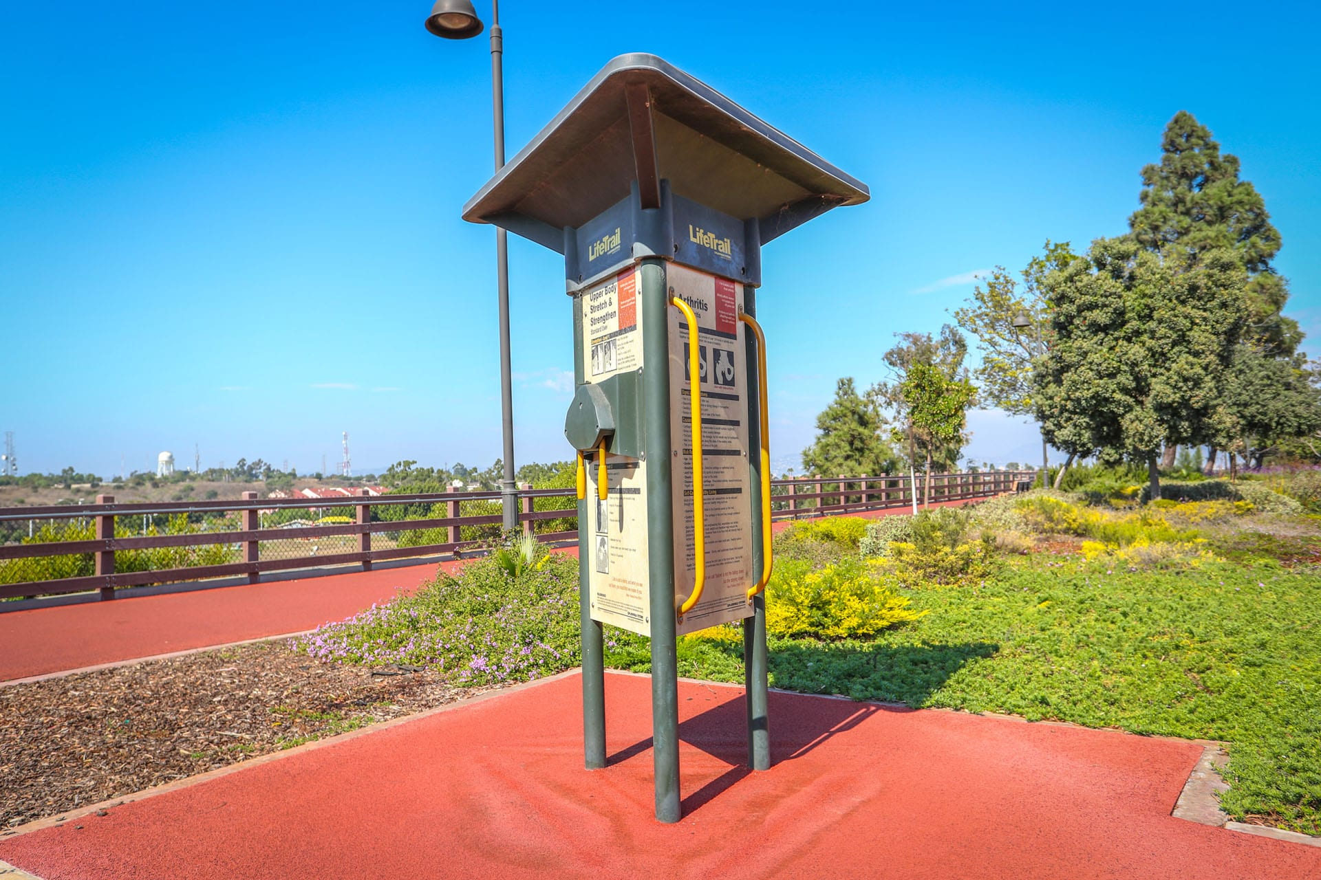 Exercise devices and informational posting next to the track