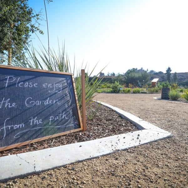 Sign reading: Please enjoy the Garden from the path