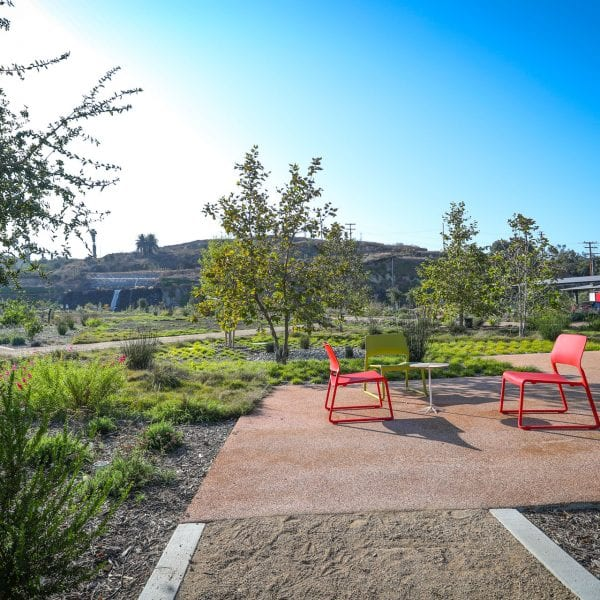 Chairs and small table on a nicely paved turf in a garden