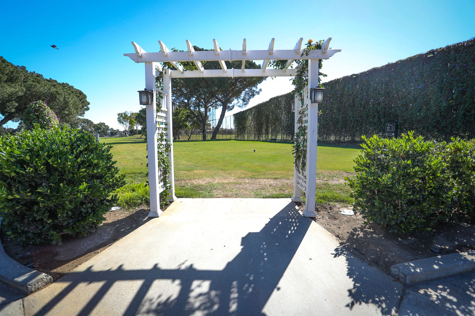 Archway to a green lawn