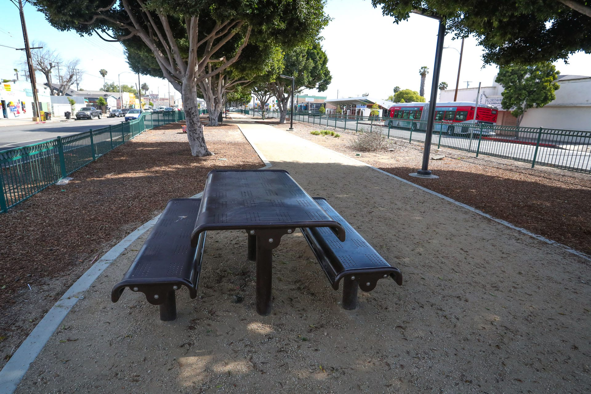 Picnic table next to bench