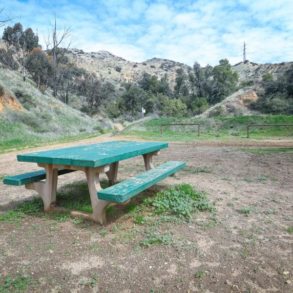 Picnic table, hills in the background