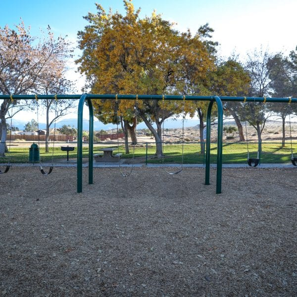 Swing set on a wood chip bed