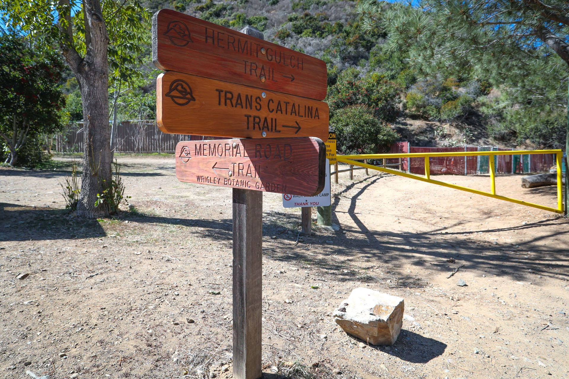 Signs: Hermit Gulch Trail. Trans Catalina Trail. Memorial Road Trail (Wrigley Botanic Garden).