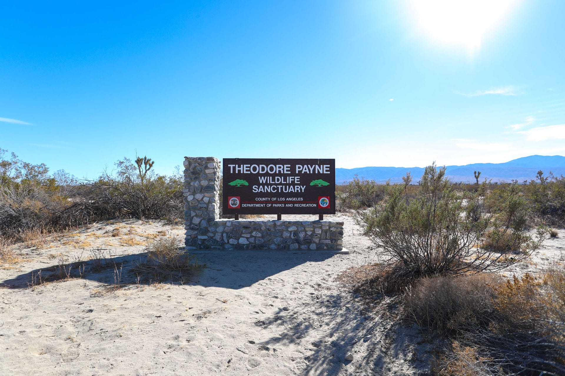 Theodore Payne Wildlife Sanctuary sign viewed at some distance