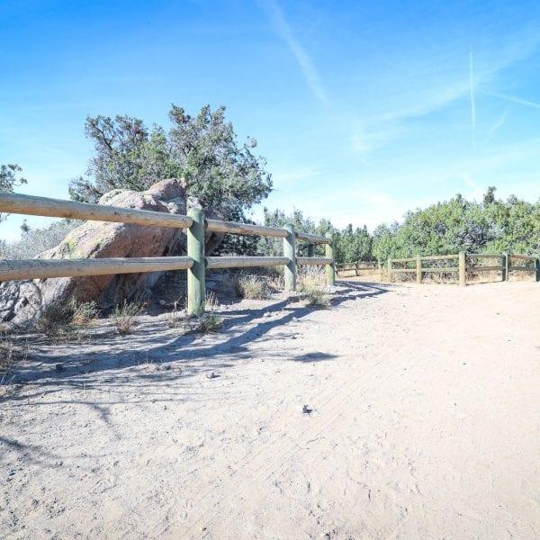 Wood fences lining a dirt lot