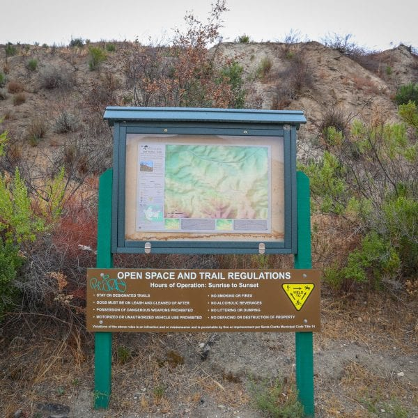 Sign and map next to hill