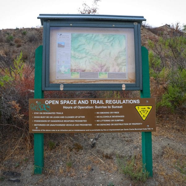 Open space and trail regulations sign and map