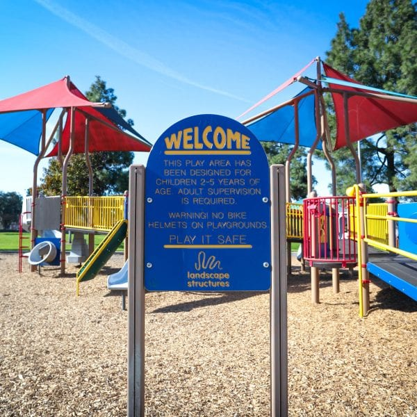 Welcome sign and playground