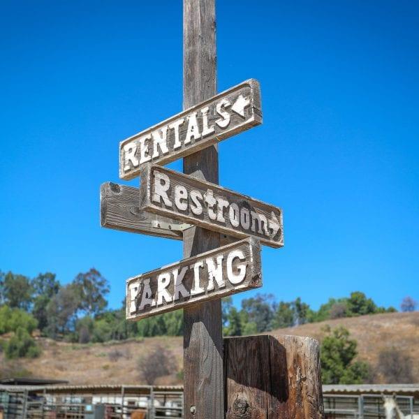 Signs: Rentals, Restroom, Parking