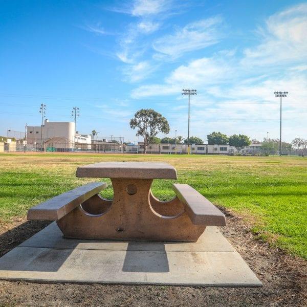 Adobe picnic table in a grassy field
