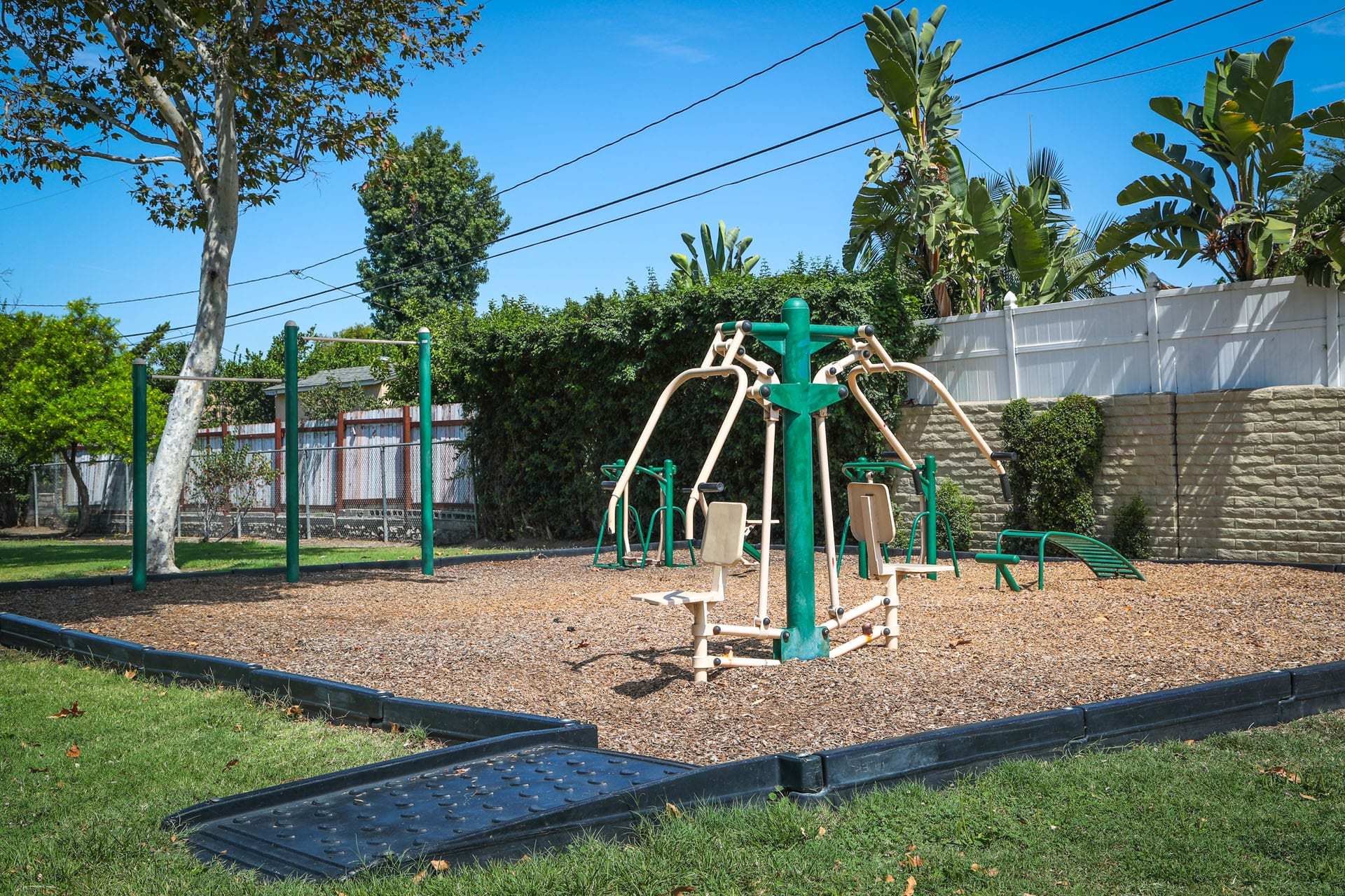 Exercise equipment on a wood chip turf