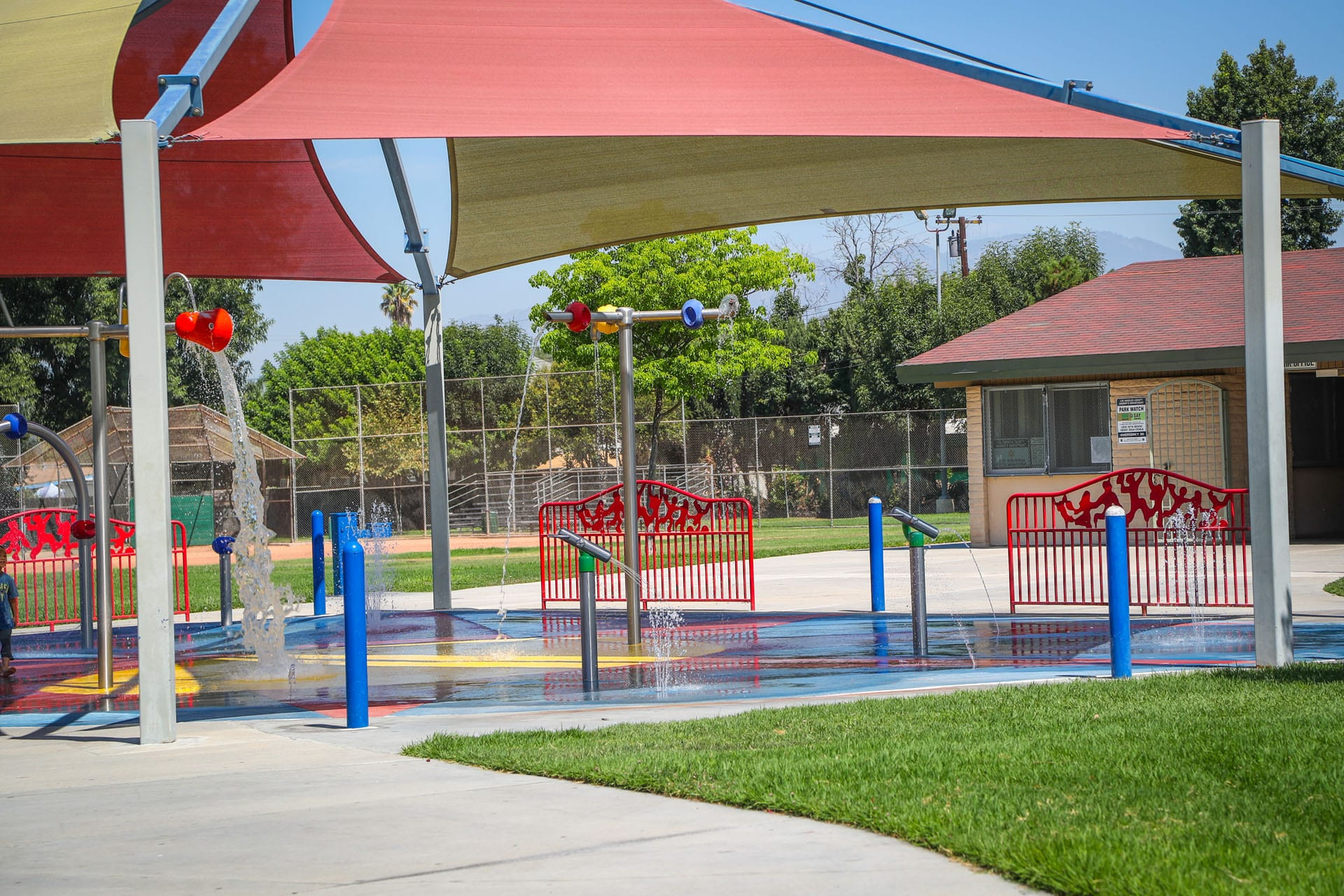 Tent-covered splash pad